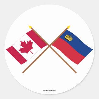 カナダおよびリヒテンシュタインによって交差させる旗 ラウンドシール