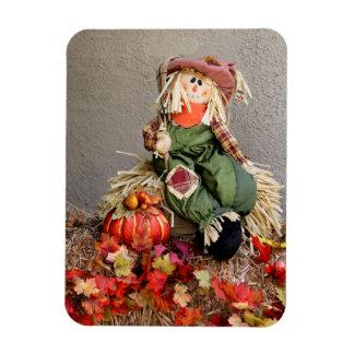カボチャが付いているかわいい秋のかかし マグネット