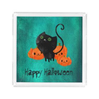 カボチャを持つハロウィンかわいい猫 トレー