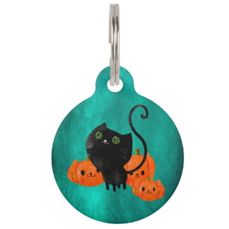 カボチャを持つハロウィンかわいい猫 ペット ネームタグ