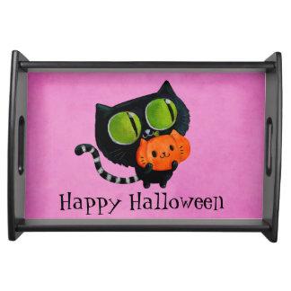 カボチャを持つハロウィンのかわいい猫 トレー