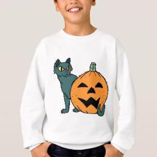 カボチャを持つ猫 スウェットシャツ