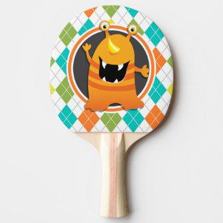 カラフルでアーガイル柄のなパターンのオレンジモンスター 卓球ラケット