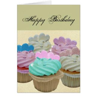 カラフルなカップケーキおよびハート カード
