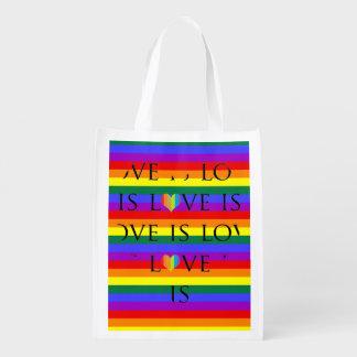 カラフルな愛は虹の背景の愛です エコバッグ