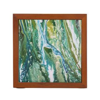 カラフルは青緑のターコイズの滝を抽出します ペンスタンド