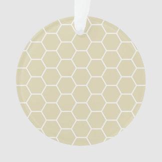 カーキ色のクリームによって着色される六角形の蜜蜂の巣パターン オーナメント