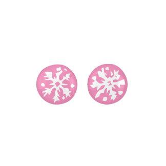 ガーリーなピンクの背景の雪片のデザイン ピアス