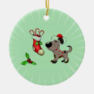 キャンディ・ケーンおよびヤドリギが付いているクリスマスのストッキング セラミックオーナメント