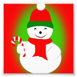キャンディ・ケーンが付いている雪だるま フォトプリント