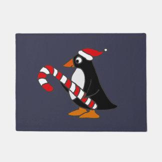 キャンディ・ケーンの芸術を保持しているかわいいペンギン ドアマット