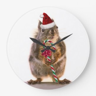 キャンディ・ケーンを持つクリスマスのリス クロック
