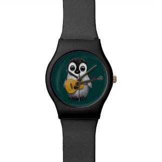 ギターのティール(緑がかった色)を遊んでいる音楽的なベビーのペンギン 腕時計