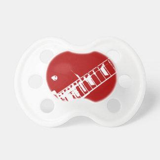 ギターの首のスタンプの赤と白の楽器 おしゃぶり