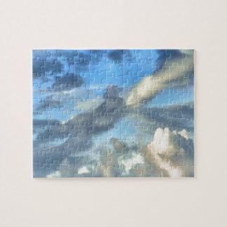 ギフト用の箱が付いている空および雲の写真のパズル ジグソーパズル