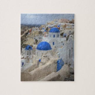 ギリシャ、Santorini。 3の鐘桜そして青いドーム ジグソーパズル