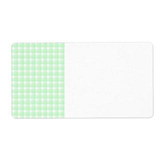ギンガムの点検パターン。 薄緑および白い ラベル