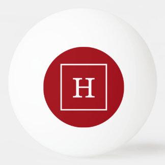 クランベリーの赤い白によって組み立てられる最初のモノグラム 卓球ボール