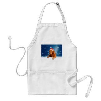 クリスマスのかわいいゴールデン・リトリーバー犬のサンタの帽子の雪 スタンダードエプロン