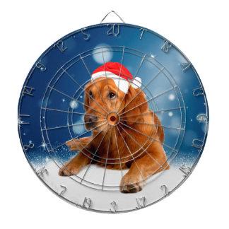 クリスマスのかわいいゴールデン・リトリーバー犬のサンタの帽子の雪 ダーツボード