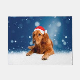 クリスマスのかわいいゴールデン・リトリーバー犬のサンタの帽子の雪 ドアマット