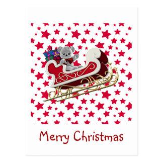 クリスマスのそりのテディ ポストカード