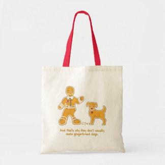 クリスマスのためのおもしろいなジンジャーブレッドマンそして犬 トートバッグ