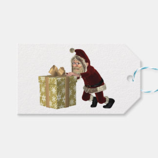 クリスマスのギフトを押しているサンタクロース ギフトタグ