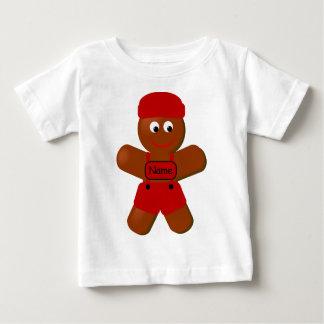 クリスマスのジンジャーブレッドの男の子の乳児のTシャツ ベビーTシャツ