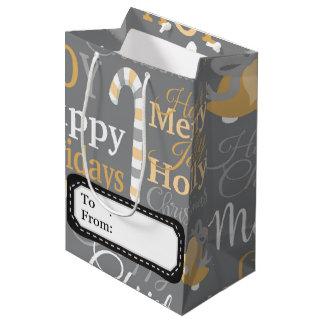 クリスマスのヒイラギの喜びパターン ミディアムペーパーバッグ