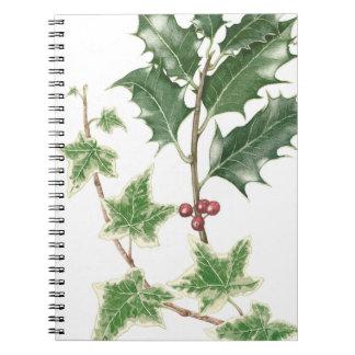 クリスマスのヒイラギ及びキヅタの小枝の植物のノート ノートブック