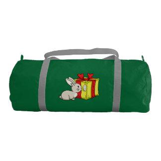 クリスマスのプレゼントが付いているバニー ジムバッグ