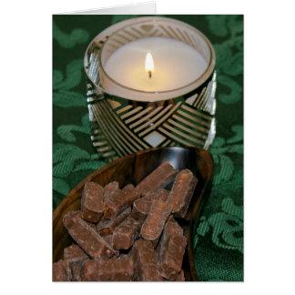 クリスマスの休日の蝋燭およびチョコレート・キャンディ カード