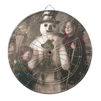 クリスマスの女の子および雪だるまのヴィンテージの写真 ダーツボード