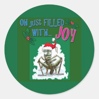 クリスマスの帽子を持つ気難しいバッタ ラウンドシール