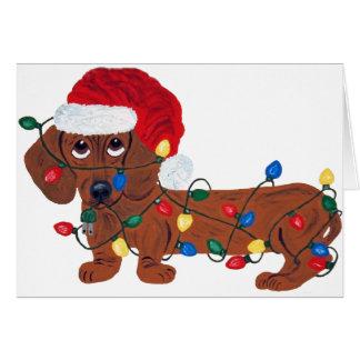 クリスマスの照明で(赤い)もつれるダックスフント カード