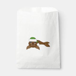 クリスマスの緑のサンタの帽子が付いているブラウンの子どものアシカ フェイバーバッグ