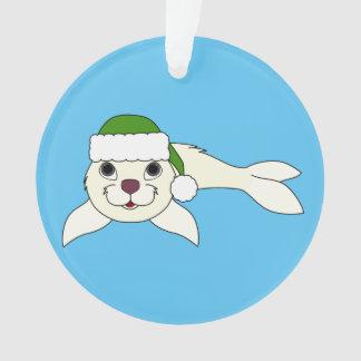 クリスマスの緑のサンタの帽子が付いている白い子どものアシカ オーナメント