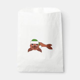 クリスマスの緑のサンタの帽子が付いている赤い子どものアシカ フェイバーバッグ