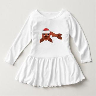 クリスマスの赤いサンタの帽子が付いている赤い子どものアシカ ドレス