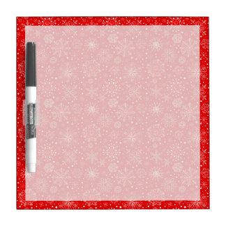 クリスマスの赤の白い雪片 ホワイトボード