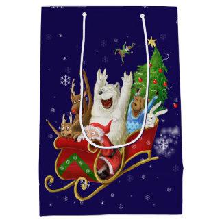 クリスマスは-シカのサンタ動物のそりの木を揺すります ミディアムペーパーバッグ