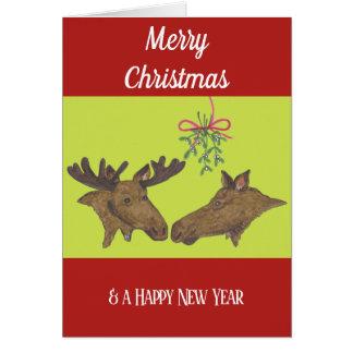 クリスマスカードのアメリカヘラジカのカップルおよびヤドリギ カード