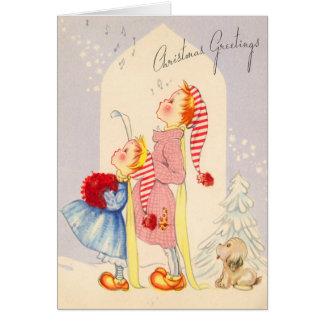 クリスマスカードを歌っているかわいいヴィンテージの子供 カード