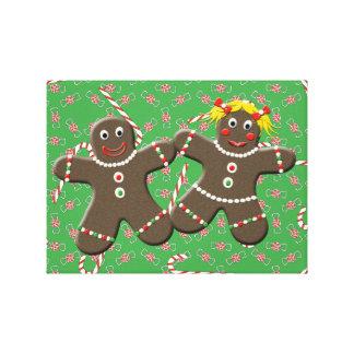 クリスマスキャンデーのキャンバスの芸術のジンジャーブレッドのカップル キャンバスプリント