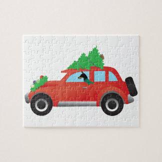 クリスマスツリーが付いている車を運転している(犬)ドーベルマン・ピンシェル ジグソーパズル
