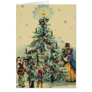 クリスマスツリーのまわりのキャロル グリーティングカード