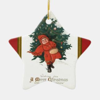 クリスマスツリーを持つヴィンテージのクリスマスの男の子 セラミックオーナメント