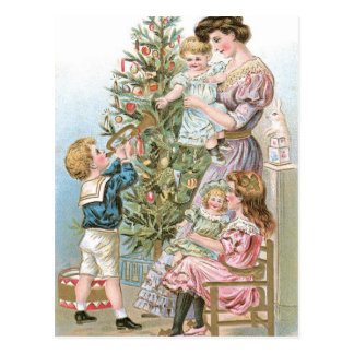 クリスマスツリーを持つ家族 ポストカード