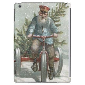 クリスマスツリーを渡すサンタクロースの三輪車